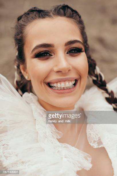 Portrait of a smiling woman with dental braces