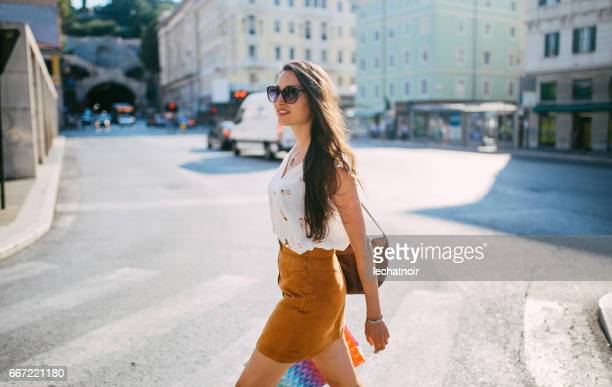 portrait of a smiling young brunette in trieste, italy - long purse stock photos and pictures