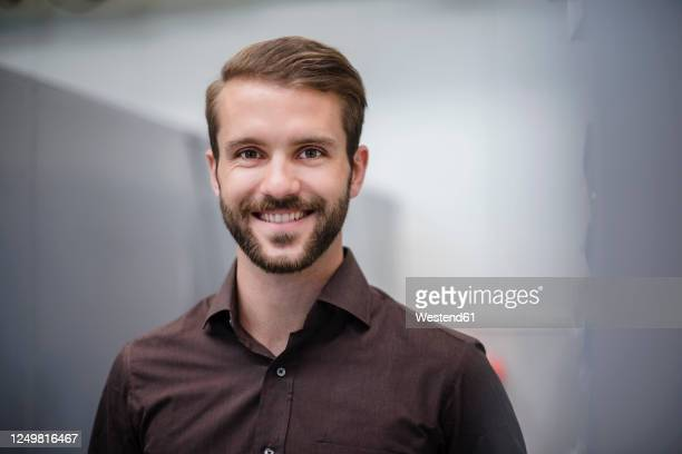 portrait of a smiling young businessman - brown hair stock pictures, royalty-free photos & images