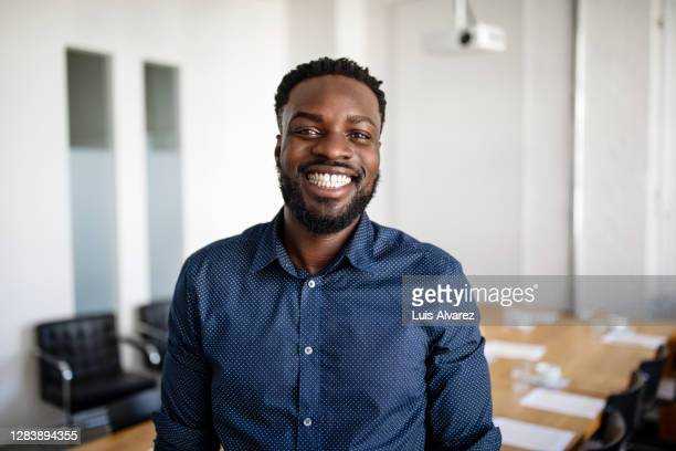 portrait of a smiling young businessman - only men stock pictures, royalty-free photos & images