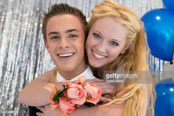 Portrait of a Smiling, Young Couple at a High School Prom