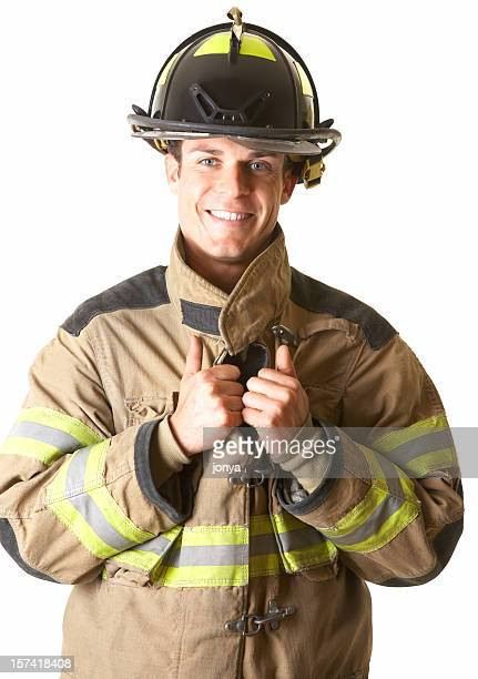 portrait of a smiling young fireman - coat stock pictures, royalty-free photos & images