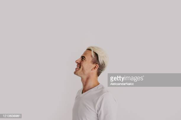 portrait of a smiling young man - bleached hair stock pictures, royalty-free photos & images