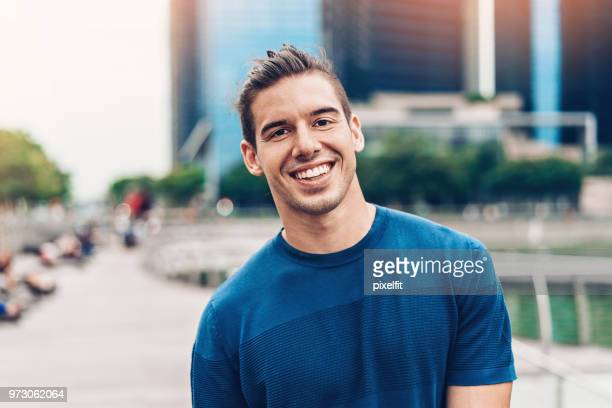 portrait of a smiling young man - waist up stock pictures, royalty-free photos & images