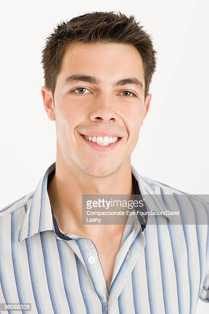 "portrait of a smiling young man - ""compassionate eye"" stock-fotos und bilder"