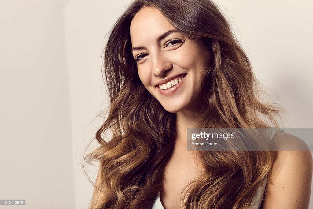 portrait of a smiling young woman : Stock Photo