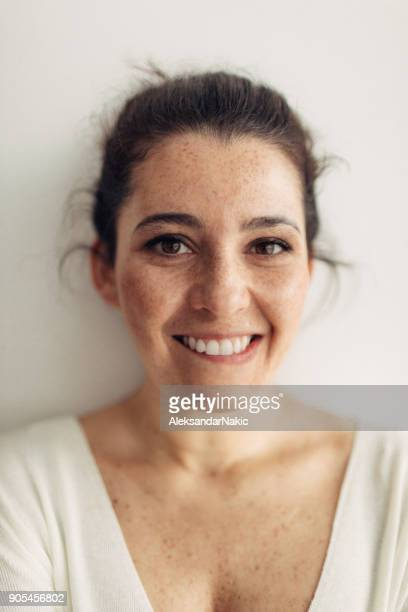 portrait of a smiling young woman - freckle stock photos and pictures