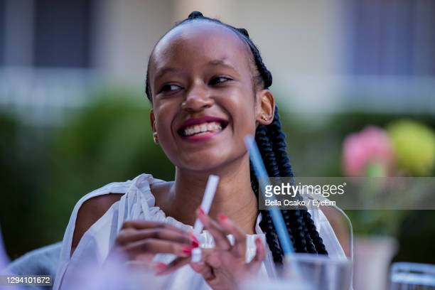 portrait of a smiling young woman smiling - nairobi stock pictures, royalty-free photos & images
