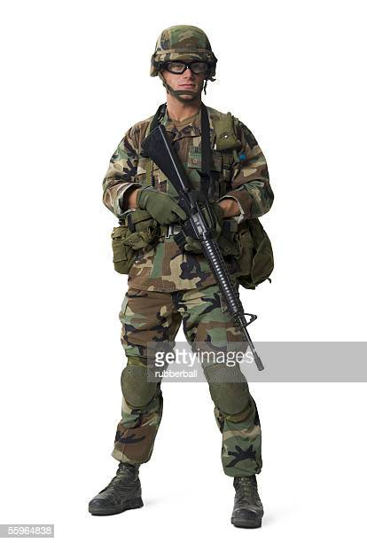 portrait of a soldier holding a rifle - boots rifle helmet stock pictures, royalty-free photos & images