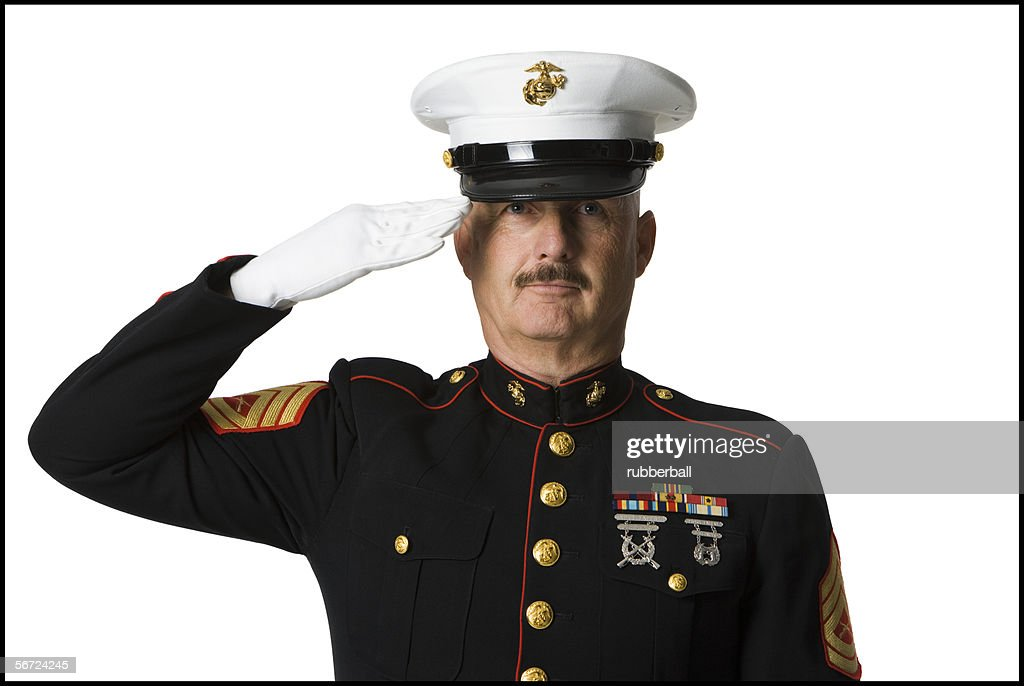 Portrait of a soldier saluting : Stock Photo