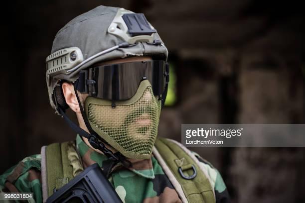 portrait of a soldier with helmet - air soft gun foto e immagini stock