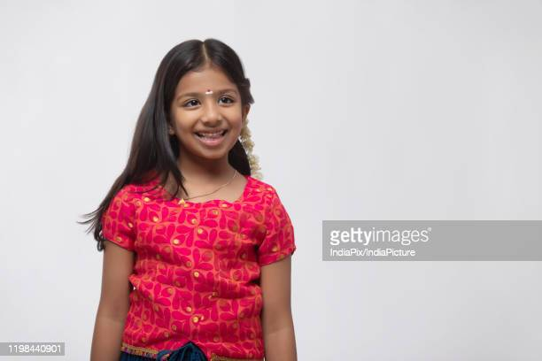 portrait of a south indian girl smiling - tamil nadu stock pictures, royalty-free photos & images