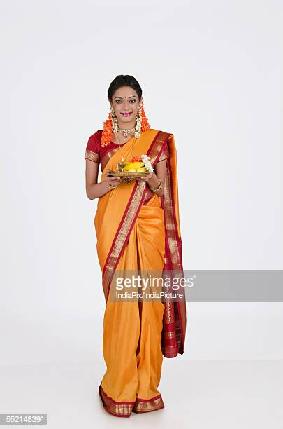 portrait of a south indian woman holding a thali - traditional clothing stock pictures, royalty-free photos & images