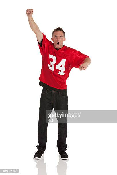portrait of a sports fan cheering - fan enthusiast stock photos and pictures