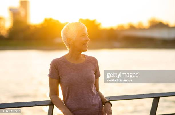 portrait of a sporty senior woman - riverbank stock pictures, royalty-free photos & images