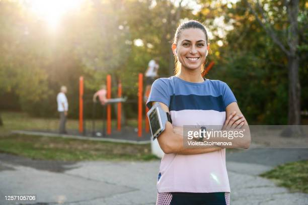 portrait of a sporty young woman outdoors. - one young woman only stock pictures, royalty-free photos & images