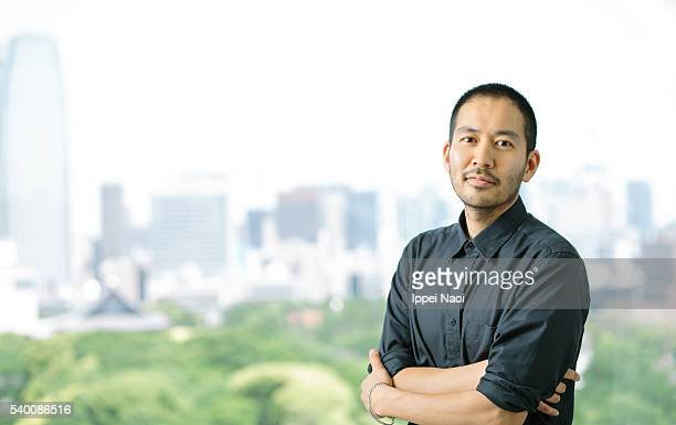 Portrait of a startup entrepreneur with a city background, Tokyo