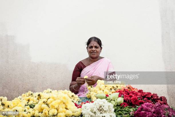 Portrait of a street flower vendor in Chennai Tamil Nadu India
