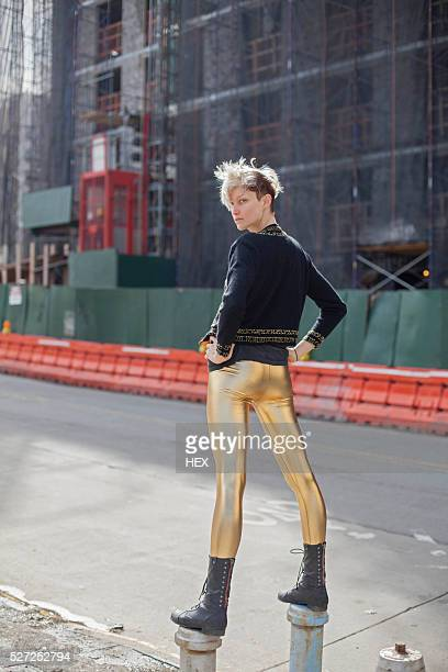portrait of a stylish young woman - gold pants stock photos and pictures