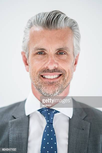portrait of a successful business man - handsome 50 year old men stock photos and pictures