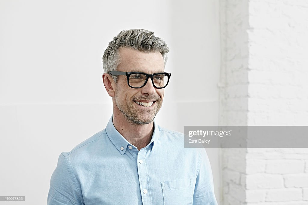 Portrait of a successful businessman in an office. : Stock Photo