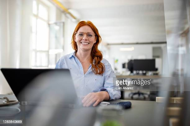 portrait of a successful businesswoman at her desk - coding stock pictures, royalty-free photos & images