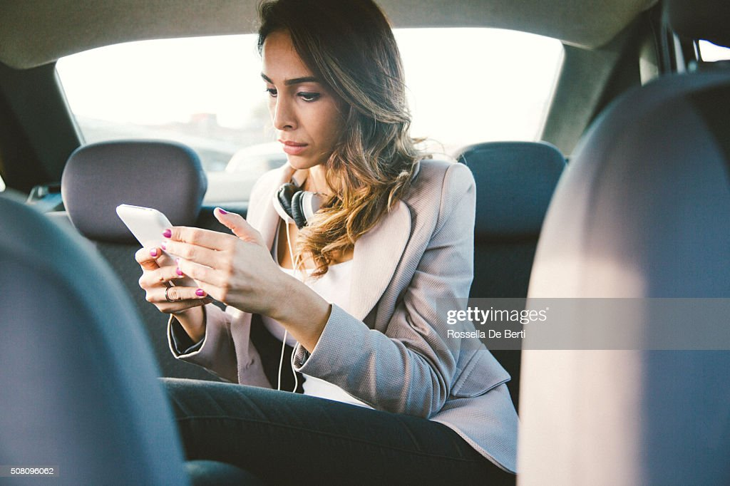 Portrait Of A Successful Businesswoman In A Taxi : Stock Photo