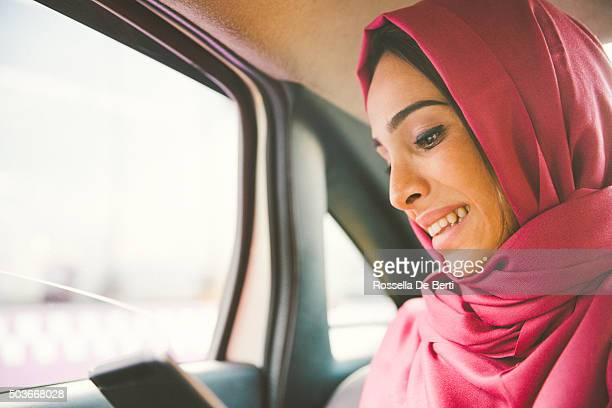Portrait Of A Successful Businesswoman Using Tablet In A Taxi