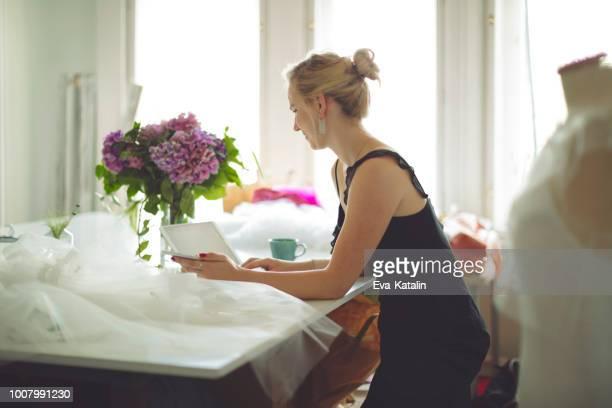 portrait of a successful fashion designer - wedding planner foto e immagini stock