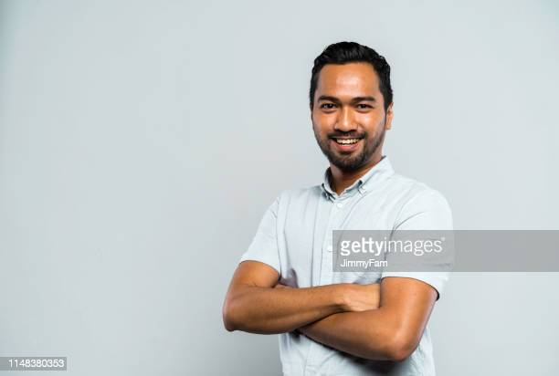 portrait of a successful malay muslim man - indonesia stock pictures, royalty-free photos & images