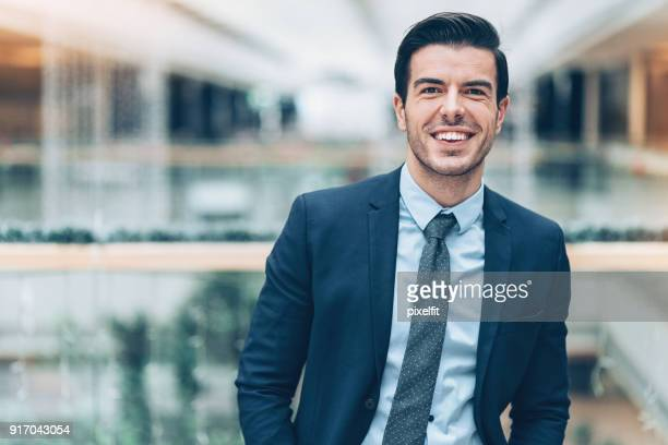 portrait of a successful young businessman - salesman stock photos and pictures