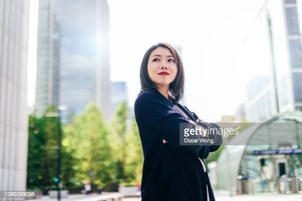 portrait of a successful young businesswoman in the city - waist up stock pictures, royalty-free photos & images