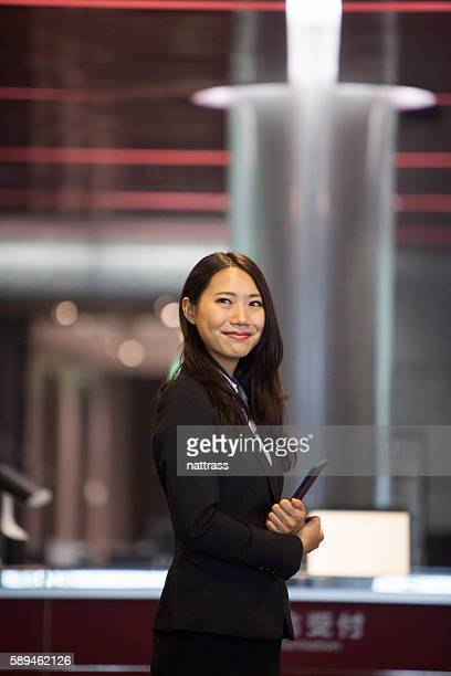 Portrait of a successful young japanese woman holding tablet