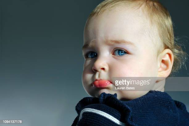 portrait of a sulking baby - cheek stock pictures, royalty-free photos & images
