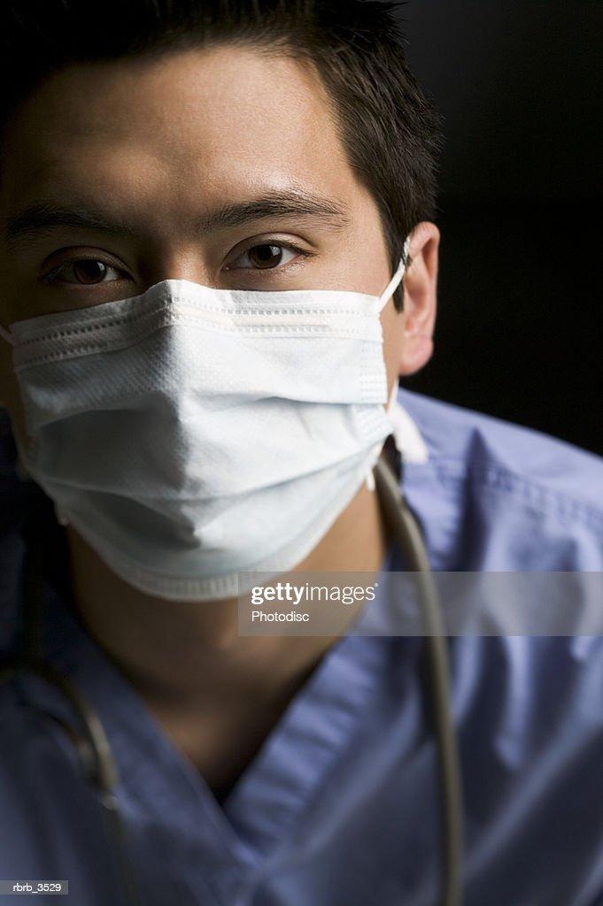 Portrait of a surgeon in scrubs : Foto de stock