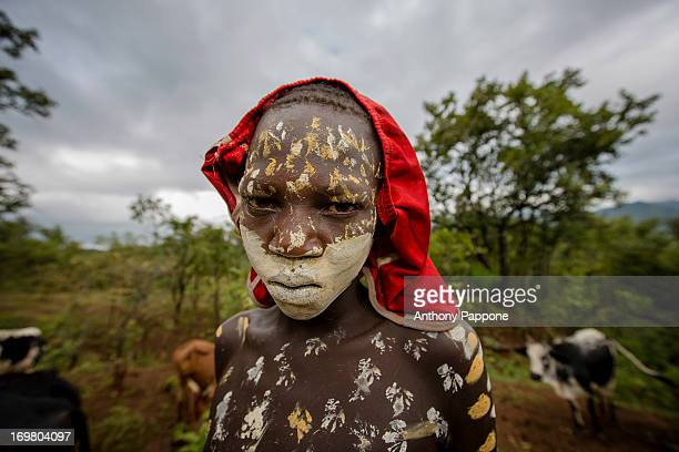 CONTENT] portrait of a suri boy tribe with the body painted lead to pasture the herd of cattle