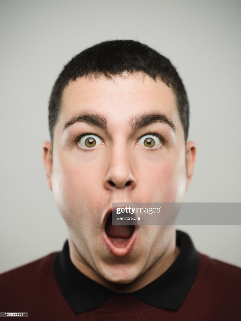 Portrait of a surprised young caucassian man looking at camera. : Stock Photo