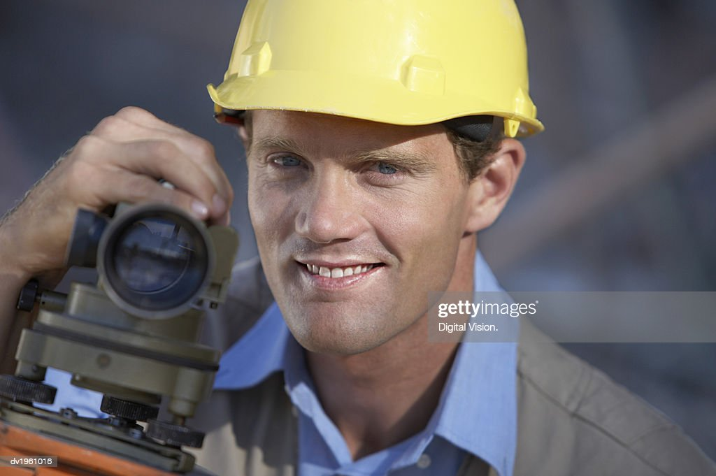 Portrait of a Surveyor with a Theodolite : Stock Photo