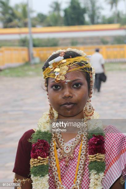 Portrait of a Tamil Hindu bride just she is married at the Nataraja Temple in Chidambaram Tamil Nadu India The Chidambaram Nataraja temple or Thillai...