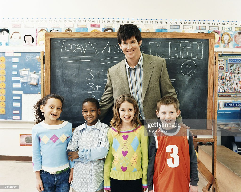 Portrait of a Teacher With Primary School Children in a Classroom : Stock Photo