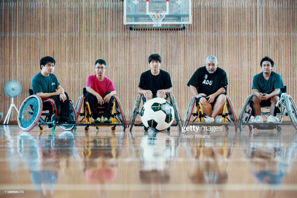 Portrait of a team of wheelchair soccer players : ストックフォト