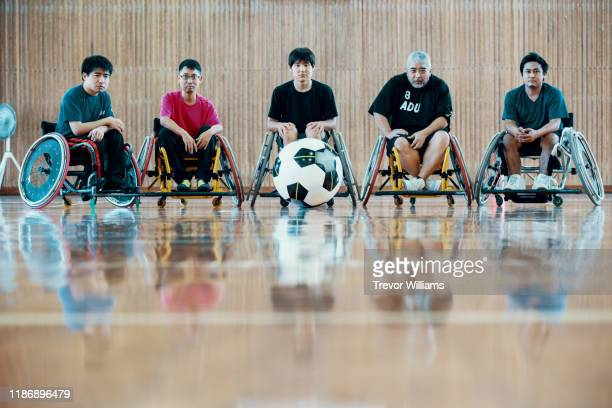 portrait of a team of wheelchair soccer players - five people stock pictures, royalty-free photos & images