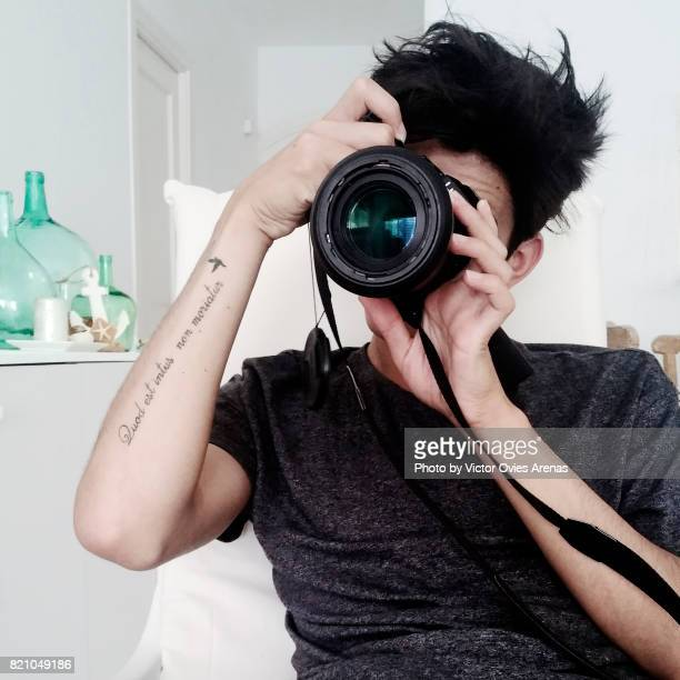 Portrait of a teen male taking a photo