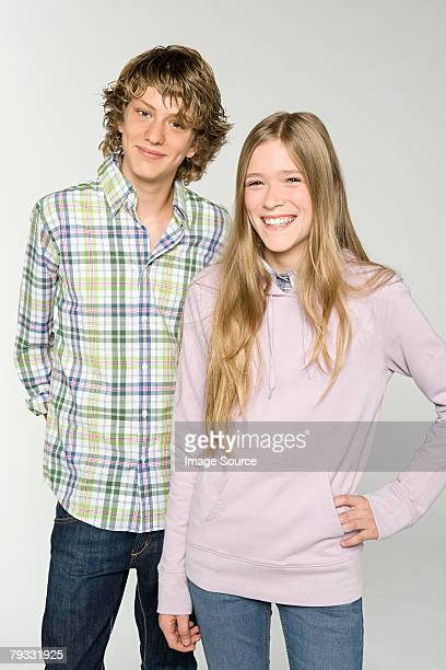 portrait of a teenage boy and teenage girl - sister stock pictures, royalty-free photos & images