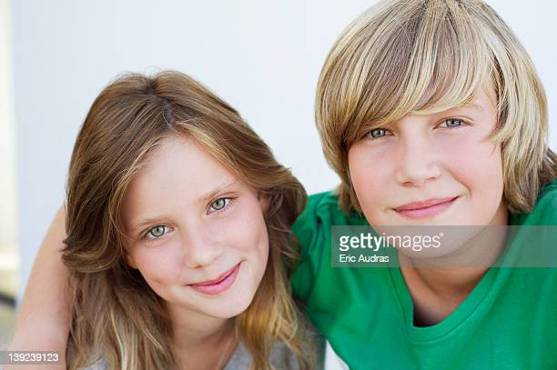 Portrait of a teenage boy smiling with his sister