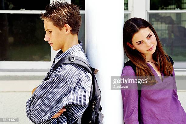 portrait of a teenage couple fighting at school - teenage couple stock pictures, royalty-free photos & images