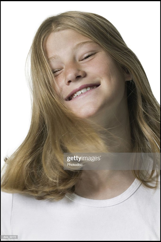 portrait of a teenage female as she playfully tosses her hair around : Foto de stock