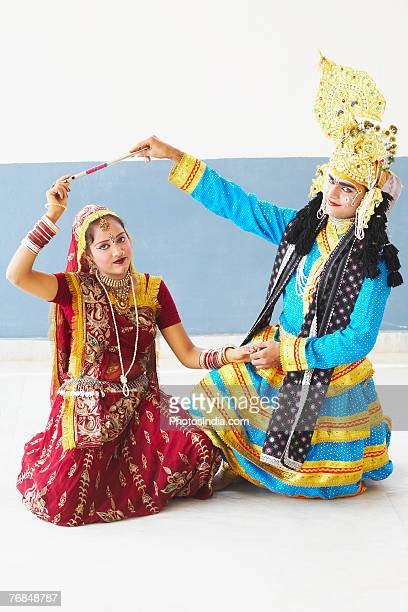 portrait of a teenage girl and a young man performing raasleela - radha krishna stock pictures, royalty-free photos & images