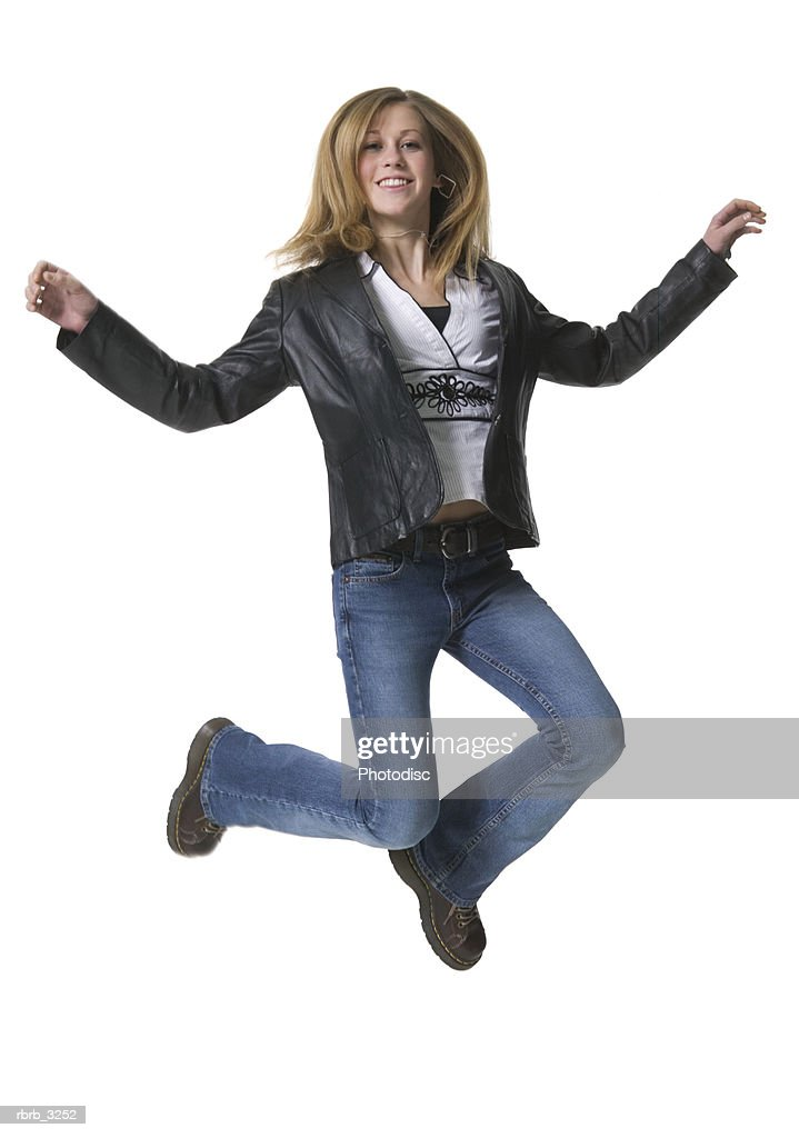 Portrait of a teenage girl jumping : Foto stock