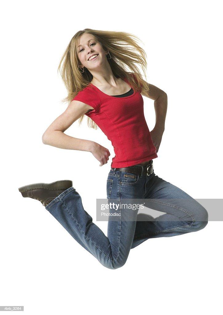 Portrait of a teenage girl jumping : Foto de stock